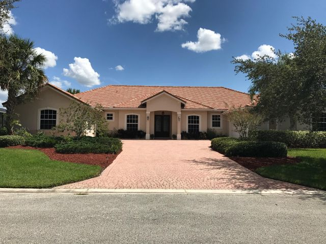 Beautiful, large open concept home perfect for entertaining located in St. Lucie West. ALL outside doors have Schlage keyless entry locks. Open formal dining, living & family rooms. Separate game/media room has wood floors & the Pool table (with ping pong top) & wine cooler are included in the sale! Kitchen features upgraded cabinetry, granite counters, breakfast bar & stainless steel appliances. 5 bedrooms 3 full baths & 2 half baths with tiled floors throughout the home. The 5th bedroom is large and has an outside entrance which makes it an ideal office. Two -zone dual AC units and water heaters for energy efficiency. The large screened patio is perfect for entertaining and gives expansive views of the 11th fairway. With over 1/3 of an acre there is room for a pool. Easy access to shopping, entertainment, Mets Stadium and I-95.