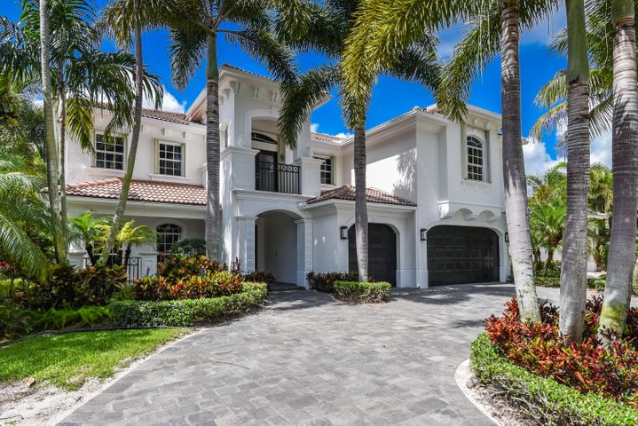 Be the first to live in this newly renovated Carrington in Mizner Country Club w/circular drive & 32'' Porcelain floors, newly remodeled kitchen w/new appliances, baths, all new flooring throughout. Accordion Hurricane shutters on all windows. Expansive back yard with over 13,000 sq ft of land w/ a highly desired Southern Exposure lot & oversized pool rarely seen in a country club! Newly landscaped and mulched. New driveway and pool deck. 5th bedroom can easily be added back to the loft- Closet and bathroom still exist- you only need to add a wall! This is a must see. Bring your toothbrush and move in. Equity membership is required. See addendum regarding the community and all amenities. Any equity may be purchased. Social, tennis, sports, or Golf Equity. Minimum of Social equity is mandatory. New 18 hole golf course, new playground, coming soon new techno-gym fitness center, and entire new lifestyle center, kid splash area, and new pool. Come and check out this Platinum Award Winning Club w/activities for all ages and this like-new home on a magnificent lot