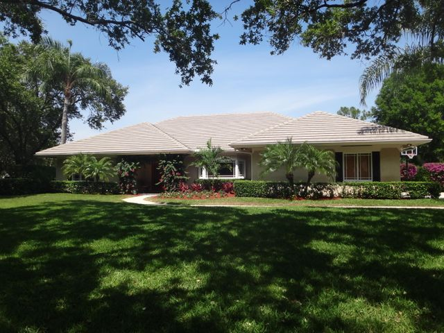 Nationally recognized, private tennis club featuring 6 championship courts located in the 24 hour MANNED GATED community of Heritage Oaks in Martin County.  Relax on the oversized covered lanai/screened pool/fenced yard.  This ideal floor plan has 4 bdrms, 3 baths, 2 car garage with extended driveway, 3 AC systems (replaced in 2015, 2018, 2019), 3 hot water heaters (replaced 2016 & 2018), crown molding, tray ceilings, concrete roof, grage door rated for up to 160 MPH, plantation shutters, wood flooring, surround system in FR, remodeled gourmet kitchen with custom cabinetry, granite counters, farmers sink, & SS appliances.  Saturnia marble floors, exterior repainted in 2018 and so many more upgrades.  See supplemental remarks for further information. This spacious single story home with formal living & dining rooms, large open family room that flows into the kitchen, covered lanai and screened pool area.  A private ensuite spa-like bath rounds up this comfortable master suite.  You will totally enjoy the nationally recognized private tennis club with private instructors.  24 hour manned gated community on the Martin County side of Tequesta.  A short distance to schools, recreational areas, medical facilities, pristine beaches, restaurants, boating, parks & entertainment.  30 to 40 minutes to the Palm Beach International Airport.