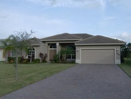 Gorgeous 4/2.5/2 Royal Professional built  Pool Home in Sawgrass Lakes The Sanctuary! If space is what you need space is what you get! Over 2400 AC Square Ft! Formal Dining & Living Room. Beautiful Tile in Main Living Areas. Open Kitchen to Family Room. Sliders in the Living Room & Master Bedroom that lead out the pool patio. Pool has Spa. Iron Fence in Back. Measurements are approximate.Poured Concrete construction.