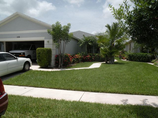 Lake Forest Pointe Gated Community. Three bedrooms, 2 baths, 2 car garage. Tile in living area, carpet in bedrooms. Split floor plan. View of lake from outside patio. Buyer to pay one time Capitol Contribution fee of $1,000 at time of closing.