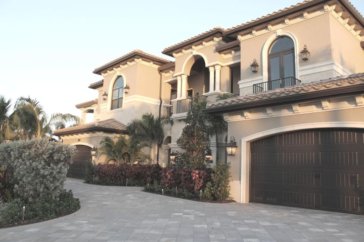 Brand New, Extraordinary Value!  Palazzo model boasts 10-foot windows and sliding glass doors, open and bright floor plan with views of the pool and lake. State-of-the-art systems integrated into the home: Lutron lighting and wiring throughout the home for, TV, sound, climate control. The kitchen features Wolf appliances, wine coolers, a 4 foot range, double ovens, two dishwashers and walk-in pantry. Outdoor living is what really makes this home special and includes two covered loggias, outdoor kitchen, resort style pool with waterfall and spa. The master bedroom suite includes a private covered balcony, wet bar, his and hers giant walk in closets.