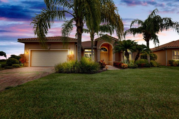 "Enjoy luxury living in this beautiful corner lot Levitt built pool home with numerous upgrades.  The property shows a tremendous love of ownership; whole-home generator, newer (2017) dual zone energy efficient A/C.  The home features, an upgraded kitchen, upgraded indoor and outdoor ceiling fans, upgraded light fixtures, gas heating stove and range.  Hurricane impact windows, transom and sliders throughout which make the home light, bright, and energy efficient while still protecting it from storms.  Recently extended lanai w/full enclosed screened pool and newer above ground $7,500 Jacuzzi/hot tub.  Spanish tile roof and gutters on full perimeter.  Separate formal living and dining rooms flow into the open concept kitchen and family room.  The master suite offers his/her walk-in closets. Tray ceilings accent the master bedroom, bath, and formal dining area.  The kitchen offers 42"" cabinets, granite counters and NEW higher-end appliances.  New high-end Washer/Dryer, Upgraded 20"" porcelain tile set on a diagonal, high ceilings and oversized crown molding throughout.  Vitalia at Tradition is a 55+ community with resort style amenities.  Enjoy an award winning 24,000 s.f. clubhouse with, a large pool & cabana, gym, tennis, pickleball, bocce, putting green, card rooms, darts, billiards, library, grand ballroom, with professional entertainment and more.  Tradition is a master planned community with winding roads and manicured landscaping to give it the look and feel of the towns of yesterday.  Beautiful vistas, lakes, recreational areas, and Tradition Square, very close to Tradition Medial Center Cleveland Clinic.  HOA fees are very reasonable and cover (full lawn and landscaping service, 24hr maned gated security)"