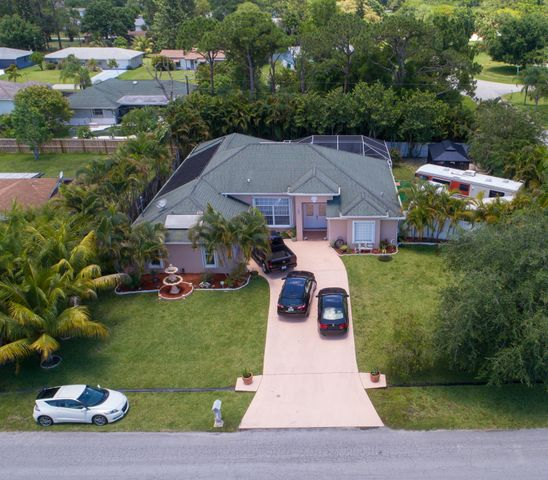 Check out this Gem, 4 Bedroom, 3 bathroom, Pool home available for sale in Port St Lucie! This home is situated on a corner lot, giving the property a larger land to play with. Enter the home with an immense welcoming space of the living room. Straight-shot view of the pool. Master bedroom features two walk-in closets, separate tub & shower, under-cabinet lighting, and more. Next we have this gorgeous 90 viewing kitchen, equipped with granite counter top, built in stove-top and dual oven. Then we have the guest bathroom that leads straight to the pool area. Another bedroom with a view to the pool, and a larger bedroom with their own separate bathroom. Enter the screened pool area, surrounded by luscious nature. Beautiful potential to be a garden home. Plenty of backyard space. There's also a backyard gate to store whatever you need with an easy access. Come check out this rare find. Very close to St Lucie West, US-1, i-95, FL-Turnpike, restaurants, shopping, parks and more. Washer & Dryer will not convey.