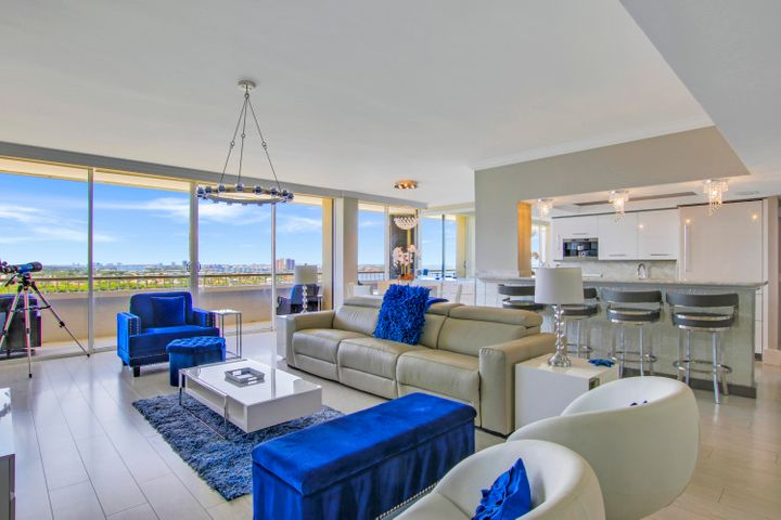 Experience magnificent panoramic long-range views of ocean, southern coastline & wide Lake Worth Lagoon from this 16th floor professionally designed and re-configured three-bedroom condo. This beautiful oceanfront residence includes rare nine-foot ceilings throughout, engineered wood floating floors above 24'' X 24'' marble, custom bar with quartzite top, wine refrigerator, glass backsplash & vessel sink. The opened kitchen offers Miele Espresso Coffee maker, built in floor to ceiling refrigerator, new appliances & glass walled island. All completely refurbished bathrooms include a steam shower in the Master with rain and handheld shower heads and double 48'' vanities w/ separate make up area. Additional features include Sonos speaker system, Swarovski Crystal lighting throughout and electric fireplace. The laundry room was totally redone with cabinets, a second refrigerator, sink base and full pantry. Includes underground parking.  Reaches is situated on 4.2 lush acres, including a tropical acre of landscaped pool deck surrounding the inviting saltwater pool & spa with several private enclaves for private relaxation. Enjoy a completely renovated casual poolside owner's lounge with a long elegant bar and seating for party's or reserved events, brand new full kitchen, billiards table and wireless internet. Work out in the ocean front gym redesigned with all new equipment, showers and saunas. Also, indoor racquet ball court, bike storage, lighted tennis court with shade and additional air-conditioned storage space.