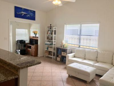 Beautiful pool home in the Heights of Jupiter. 3 bedroom plus a bonus room that can be a 4th bedroom. Spacious master bedroom with walk in closet, dual sinks in bathroom with a private entrance to the screened in pool.  New AC 2018, vaulted ceilings, awesome floorplan with 2 separate living areas. Great neighborhood with no HOA, quiet neighbors, close to Heights Blvd, A rated schools, minutes to the beach, entertainment and I-95. The garage can be converted back to garage at the seller's expense.