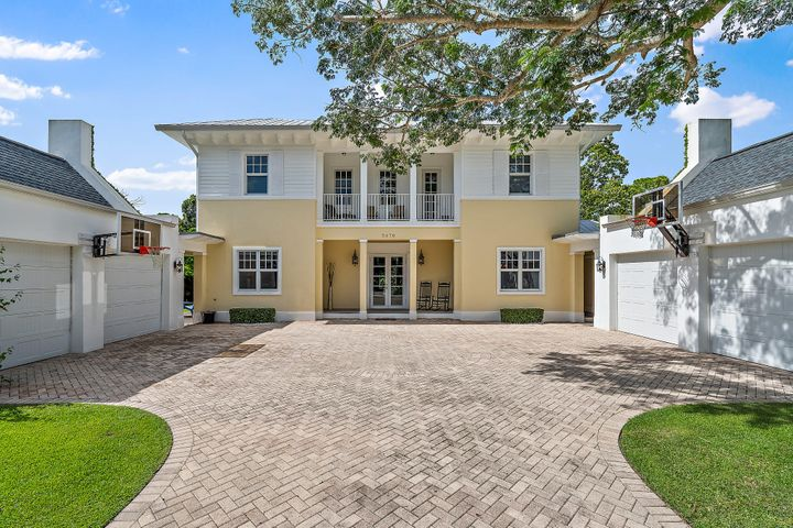 This Stunning British West Indies style home is newer 2010 construction and sits on a 1/2 acre in Jupiter's sought after PENNOCK POINT. Meticulously designed w/ no detail missed. Chef's dream w/ top of line professional gas SS stove/grill. Large granite island workspace, counter seating, wide plank wood floors throughout and coffered volume ceilings. First floor Master bedroom has his/her closets and water closets. Four spacious Guest suites. Other features include Solar panels, electronic security driveway gate. Two (2) car garages and central vac. Outdoor tropical oasis with butterfly garden, oversized pool, expansive summer kitchen, firepit and cabana bath w/ shower. Impact glass through-out. Whole house generator w/ 500 gallon in ground propane tank. A Perfect family home! A MUST SEE! Pennock Point is one of the most popular and sought after neighborhoods in Jupiter with land, water and No HOA. Great schools!  The beaches are 5 minutes away. Favorite restaurants, Guanabana's, Utiki, 1000 North and Harborside are minutes away. The airport and Palm Beach is 25 minutes away with easy access to I95.