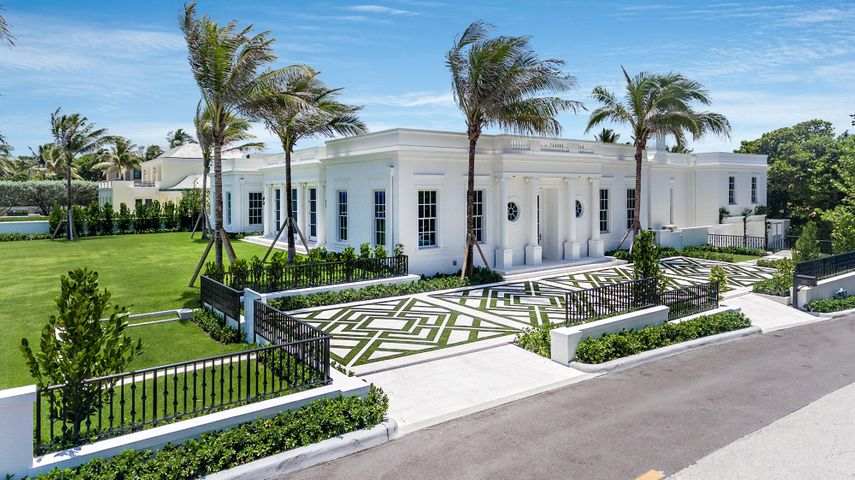 """Rarely does an oceanfront home of this caliber come along.  This newly renovated home was built from the ground up to the highest quality. This crisp, classic Regency-style 4 BR/6.1 BA home with pool and pool house is pure perfection. Designed for today's buyer, this important 6,274 square foot home has high ceilings, bright open floor plan, and high-end, tasteful finishes.   Relish the captivating ocean views from both the living room and 2 bedrooms. The master BR features 2 large, stunning his/her bathrooms and closets.  Pale wood European oak floors and large doors opening to fabulous outdoor areas are ideal for casual elegance and entertaining.  State-of-the-art white chefs kitchen with top-of-the-line appliances, electronics, etc.  Hurricane impact windows and retractable sliding door throughout with invisible screens, shades and much more. Two car garage. Located on """"Billionaires Row"""" and only minutes to midtown. 130' of vacant oceanfront with private beach access. High elevation of 20'. NOT TO BE MISSED."""
