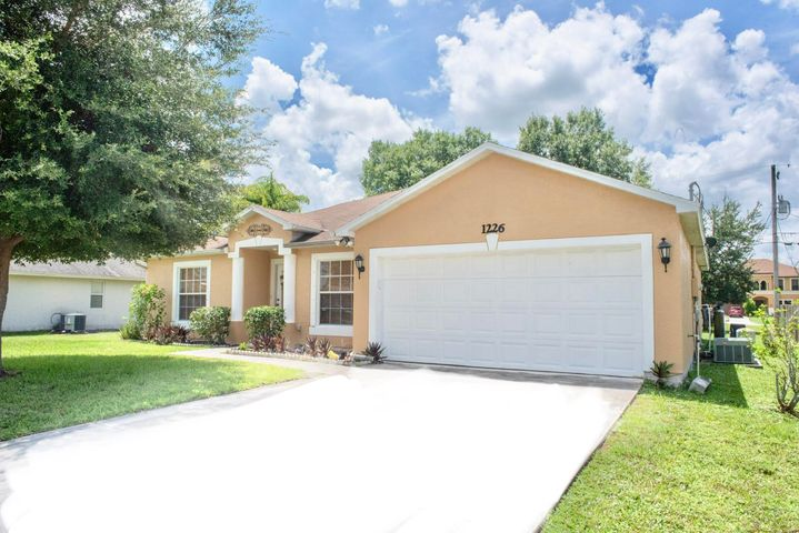 Come see this 3 bedroom 2 bath home located in a desirable and convenient area, close to I-95, Turnpike, and minutes from the popular Gatlin and Tradition area. Home features a formal living and dining area with an open kitchen that flows from the front to back of house, split floorpan, screened patio and only tile and wood floors! Home is is well maintained and kept. Come see for yourself now!