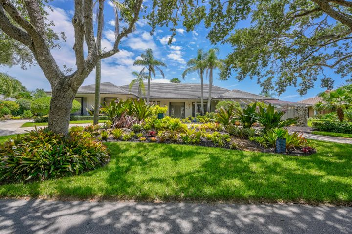 Heritage Oaks is deeply rooted in the history of the North Fork of the Loxahatchee River. This beautiful waterfront 4/3/2 home has many custom features. It is a great place to entertain inside or out. Great water views and wildlife sightings. Extra features include: over-sized 2 car garage, wood burning fireplace, abundant lovely wood kitchen cabinets, granite in kitchen and baths, oak wood and travertine marble floors, two separate sink preening area in master, Howell humidifier, central vacuum, Orchid House and boat dock with whips. The neighborhood advantages include: beautiful oak lined streets, large lake, locally famous tennis program, cable, ADT security and trash pick-up from garage doors. Take your boat for evening sunsets on the Loxahatchee or early morning ocean fishing.  ADT security and trash pick-up from garage doors. Take your boat for evening sunsets on the Loxahatchee or early morning ocean fishing. See opsrey, manatees, herons, and eagles from the dock of your tropical paradise. Enjoy the best of Old Florida while swimming in your pool overlooking a mangrove preserve.