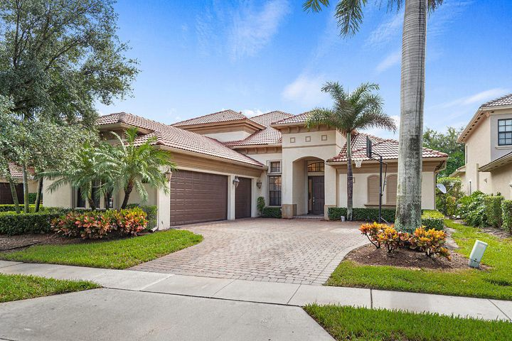 Beautiful 5 bedroom home plus loft, 3 car garage, sited on an oversized lot backing to a private canal. Located in central Delray Beach in the elegant gated community of Casa Bella. Upgrades include, ceramic and wood floors, marble master bathroom, custom window treatments, moldings, built ins and closets. Stainless steel appliances, Natural Gas cook-top and hot water heater. 2 zoned A/C.  Impact glass and accordion shutters protect the home. Large covered patio and nicely landscaped yard with pool and spa. This home must be seen to be truly appreciated