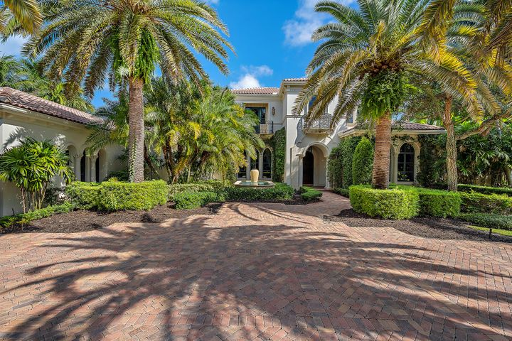 This elegant Mediterranean style home sits on a secluded 2/3 acre homesite in the sought after Grand Estate section of Old Palm. The unique location of this home w/ only 3 homes on the street & no neighbors across from you is ideal for the client who seeks privacy.   Spacious kitchen w/SS Dacor double ovens, 6 natural gas burner cooktop, warming drawer & micro. Subzero refrigerator, 2 dishwashers. Lg island w/ lots of cabinet space, sink & disposal. Sit down bar, Walk-in pantry & butlers pantry. Oversize 450 bottle wine room w/display window & media room. Marble floors throughout, crown & coffered ceilings. Summer kitchen w/T&G ceiling. Master has separate sitting room, hIs & her baths & closets. Impact glass. 6 bedrooms, plenty of room for the whole family, perfect to make your own! Golf membership with beach club membership available but not mandatory.
