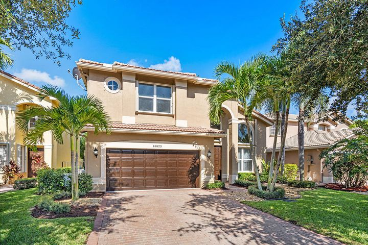 Incredible updated Savoy model featuring impact glass, new flooring, marble counter tops, redone pool and patio, whole house generator, custom built ins, moldings, window treatments and so much more. Why build new when you can have it all plus a renovated private pool with new marble pavers and custom faux grass. Featuring one bedroom and one bath downstairs, master bedroom with his and her own bathrooms up with 2 additional bedrooms up. Porcelain flooring set in herringbone formation, laminate wood floors on stairs and bedrooms. Well water for landscaping, custom water treatment whole house system. This home must be seen to be appreciated.