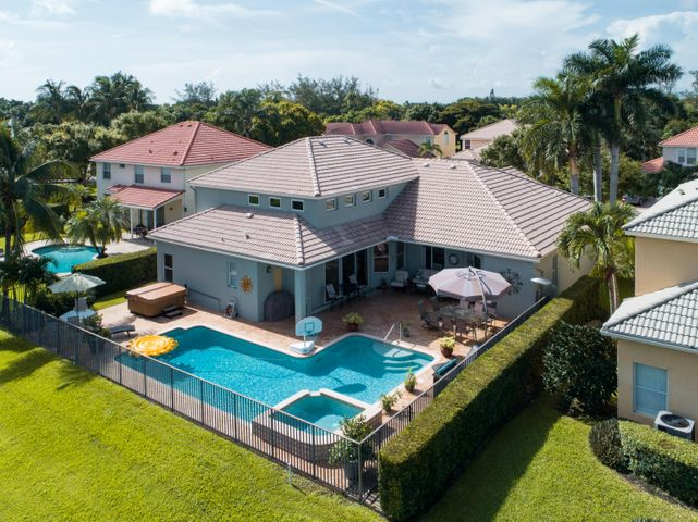 Impeccably maintained waterfront/pool luxury home designed to perfection! Versatile quadruple split floor plan features 5 bedrooms, 4 baths, 3 car garage and privacy for all! Spacious interior boasts a master retreat with two custom walk-in closets and a large spa bath, open island kitchen w/breakfast room to enjoy the tranquil views of your sparkling heated salt water pool/spa on the lakefront, loft & bonus room.  Patio is perfect for outdoor dining and entertaining with additional stand alone Jacuzzi. Recent upgrades include impact windows, generator connection, solar hot water, reverse osmosis water filtration, custom lighting, and more.  Exclusive gated community of 48 homes.  Only minutes to the Florida Turnpike and 10 minutes to downtown Delray Beach!