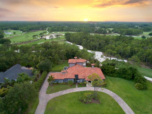 "A truly amazing Custom Estate Home is now available in the Old Trail section of Ranch Colony. This magnificent and unique old world style custom residence with authentic imported ''old world'' artisan hand crafted clay roof barrel tiles, nailed, glued and cemented the traditional way combined with the exterior off-green palette which has roots in Mediterranean landscapes but with a twist--the tone-on-tone scheme creates soft shadows that bring forward subtle color and texture variations from the materials of the house walls that provide a signature look in this style.The beautiful interior contains an eclectic mix of French, Spanish, and Italian styles in this amazing quality custom estate home, located on a 1+ acre parcel, it sits adjacent to the 3rd tee of the exclusive Tom Fazio go course. Built in 2008, this bespoke home is truly one of a kind, with no expense spared in the construction and finish.   The home features four bedrooms, three and a half bathrooms, two offices (his/hers), a formal dining room, a butler's pantry, a large custom professional style gourmet kitchen, a magnificent custom built dedicated eight seat home theater themed in the romantic style of the ""fabulous fifties"" with hand painted laser aligned striping , an adjacent billiard / game room, as well as an additional bonus room.   The home's unique custom features make this truly one of a kind and include French set artisan hand chiseled edge travertine tile flooring throughout the living areas and rich mahogany wood flooring in the bedrooms, 10'-13' ceilings with triple trays, double crown molding and 9' high custom pocket sliding doors which line the open living area and kitchen, offering expansive views of a gorgeous patio with custom outdoor fine kitchen, infinity pool with spa, and golf course.   As you enter through the rich custom made exterior door, you find a magnificent formal dining room with ceiling cove lighting and French doors opening into a private enclosed courtyard. Fully equipped kitchen with custom cabinetry, gourmet gas oven and stove, spacious granite counter space, walk in pantry, mosaic backsplash, Artisan styled hand carved granite farmers sink, and a butler's pantry with wine cooler. A multi-purpose bonus room with a private entrance looks out onto a small courtyard and adjoins the 3.5 car garage offering potential space for a private gym, storage, or in-law suite or maid's quarter.  On the second level, a plush eight seat movie theater and separate billiard / game room, which opens out onto a Mediterranean style balcony with breathtaking views of the golf course, yard, and pool complete this magnificent home. Conveniently close to Urban Resources but with the feeling of privacy Ranch Colony is an exclusive guard gated community in Jupiter, offering many lifestyles with five unique neighborhoods all nestled in lush natural foliage.  Each neighborhood comes with its own special interests and charm. Tailwinds, a private airpark community, Ranch Estates and Ranch Acres, with mini ranches and large, 20+ acre estates, Cypress Links, a Dye Preserve golf community and Old Trail, which is part of the exclusive Jonathan's Landing Country Club community in the heart of Jupiter. Old Trail has been described as one of Tom Fazio's best designs and is considered the true championship course at Jonathan's Landing. Golf membership is optional. Additionally, Ranch Colony is centrally located just 10 minutes to I-95 and the Florida Turnpike. Only 28 mins to some of the finest beaches and restaurants in Florida, as well as the PGA and Gardens Mall, which are only a 20 minute drive away. The Palm Beach International Airport is just under a half hour drive. tranquil, exclusive, but convenient without doubt no other location can  claim the luxurious, Eco-rich resources of this private, gated community called Ranch Colony  NEWLY PAINTED EXTERIOR 11/19 NEW AC UNIT - POTENTIAL 5TH BED/STUDIO WITH SEPERATE ENTRANCE - MUST SEE"