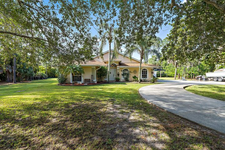 CBS 1995 year built home situated on 1.15 acres completely fenced with a screened in pool! Split Floor plan with spacious master bedroom and en-suite with soaking tub. Offering 3 Bedrooms + an office/ Den and 2 Bathrooms. Beautifully landscaped