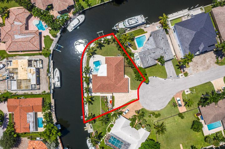 A RARE OPPORTUNITY TO PURCHASE A TROPHY WATERFRONT PROPERTY!!  THIS  SOUTHEAST POINT LOT  PROPERTY (.32 ACRES) OFFERS THE ULTIMATE BOATER'S LIFESTYLE!LOCATED IN THE HIGHLY DESIRABLE COMMUNITY OF GOLDEN HARBOUR, AND JUST MINUTES TO THE BOCA INLET AND THE ATLANTIC OCEAN.THIS SPECIAL PROPERTY OFFERS 219 FEET OF WATER FRONTAGE AND FEATURES A CONCRETE, BATTER PILED SEAWALL WITH PROTECTED DOCKAGE FOR MULTIPLE YACHTING VESSELS. DOCKAGE IS 202 FEET IN TOTAL LENGTH.THE WELL MAINTAINED THREE BEDROOM, TWO AND ONE HALF BATH HOME WAS RENOVATED IN 2010 AND OFFERS IMPACT WINDOWS AND DOORS THROUGHOUT. QUALITY UPGRADES INCLUDE  UPDATED BATHS AND KITCHEN WITH THERMADOR APPLIANCES AND QUARTZITE COUNTERTOPS.OUTDOORS, THERE IS A NEWLY UPDATED AND HEATED SALTWATER POOL WITH A SUN SHELF. IN ADDITION, THERE IS A NEW BRICK PAVERED DRIVEWAY.  THE DESIRABLE WATERFRONT COMMUNITY OF GOLDEN HARBOUR IS WITHIN WALKING DISTANCE TO THE BEACH AND TO MIZNER PARK, WITH ITS MULTITUDE OF FINE SHOPPES AND RESTAURANTS.  DELRAY'S FAMED ATLANTIC AVENUE IS JUST A SHORT DRIVE AWAY.  THREE INTERNATIONAL  AIRPORTS ARE WITHIN AN HOUR'S DRIVE, AS ARE MULTIPLE CULTURAL AND SPORTING EVENTS.