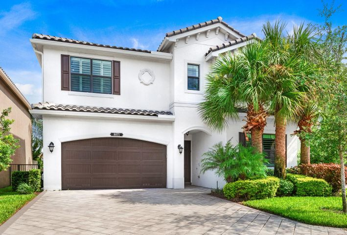 This MODERN Siena model has 4 bedrooms (1 downstairs), 3 full baths, loft, open floor plan, covered patio w/extended pavers, fenced-in yard that sits on a direct lakefront lot and a 2 car garage. This home boasts an amazing Chef's kitchen w/ both a center island & peninsula, 42'' white soft close cabinets, quartz countertops, glass tile backsplash, under-mount lighting, upgraded S/S appliances & under-mount sink w/ upgraded faucet. The kitchen also has roll-outs throughout lower cabinetry including a double trash rollout & custom shelving in pantry. The Culligan water filtration system and instant hot water spout are an added bonus!! Gorgeous contemporary wood-inspired porcelain plank tile in main living areas. Full bedroom & bathroom downstairs w/shower, quartz countertops & stylish wallpaper. Beautiful crown moldings, plantation shutters and custom lighting throughout. The Master retreat boasts a coffered ceiling, his & hers built-out walk-in closets, square dual sinks with marble countertops, Roman tub, and a walk-in shower. Laundry room upstairs has added cabinetry with pull out hampers & utility sink. Additional features include floating TV console & shelving in the living room, extra storage under stairs, nest, ring doorbell, ceiling fans, high hats, built out closets, framed out mirrors, house is wired for speakers, remote-controlled electric roll down patio screen, impact windows/ doors, whole house gutter system, epoxied garage floor & widened driveway.TUSCANY NORTH has a 24/7  MANNED GUARD GATE and amazing amenities with pool, splash park, tot lot, tennis courts, indoor/outdoor basketball, card room, clubhouse and manager on site. All ages community with LOW MONTHLY DUES!! Minutes to the Delray Marketplace and only 7 miles to downtown Atlantic Avenue & Beach.