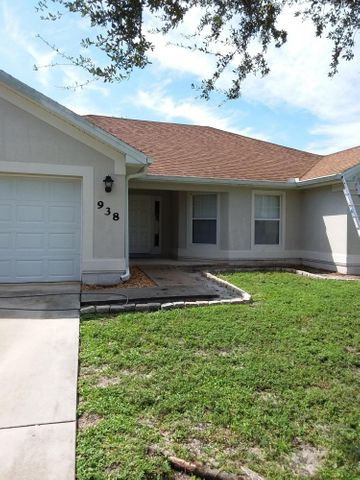 Spacious 3 bedroom 2 baths home with over 2600 sq. ft. total, large and bright with open floor plan, eat in kitchen, large rooms, tile flooring in living areas, wood laminate in bedrooms, large open kitchen with lots of cabinets and stainless steel appliances,  two car garage , garage door opener. centrally located in St Lucie West. Easy access to turnpike and I-95 , near schools and shopping. SELLER MOTIVATED!!!!!!!