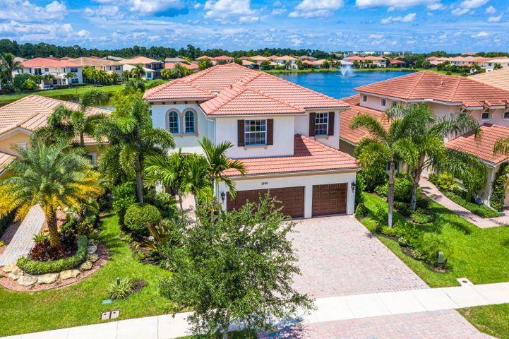 """Homebuyers in the know can tell you this: For quality, you come to Kolter. For the best gated location in Palm Beach Gardens, you come to Paloma. This amazing home offers 5 bedrooms, 4 baths, and over 4,000 air-conditioned sq. Automotive enthusiasts will appreciate the climate controlled 3-car garage that offers custom storage solutions and two high capacity automotive lifts, increasing storage capacity to five vehicles. If you love an oversized kitchen, huge family room, formal and in-formal eating areas, this is your home. The private dining and living room are ideal for entertaining while the home's oversized casual areas make daily living a breeze. A first floor office (or bedroom), full bath, huge storage areas, and custom utility room are perfect for all types of living and working situations.   This home was Kolter's builders-model for the """"Gardenia"""" floorplan and benefited from numerous upgrades namely a premium lake view lot with stunning water views. The coveted optional """"Sky Deck"""" patio increases backyard space and provides a haven of solitude overlooking the lake and salt-water pool / spa. The home has a custom-built two-story screen room with solar screening to increase privacy while reducing UV exposure and heat.   The master suite is very large and offers tremendous space to relax. This oasis is fitted out with custom millwork, soothing color palate, private door to the sky deck terrace, stunning views of the lake, sitting area, large custom closets and a spa like bath with top of the line finishes.   Guests enjoy an oversized private bedroom (en-suite). Family members will love the two large additional bedrooms and additional bath; all closets are custom. An upstairs laundry room and storage galore round out the home's sleeping quarters.   Families, sports fans, and movie buffs will find the media room ideal for gaming, movies, or the perfect spot to cheer on the favorite team! Complete with massive custom storage, three flat screen TV's, this space """