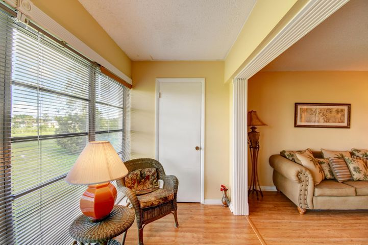 Updated and meticulously maintained 2nd floor unit with open green expanse from your large windows. Patio is enclosed into living space for extra living sqft. Laminate wood floors throughout. Both baths updated with new vanities, counters, hardware, lights, mirrors. Walk in closet has laminate as well. Kitchen has newer appliances and peek thru to dining area, plus eat in kitchen area. Lots of natural light, shows meticulously clean and a neutral palate. Leasing ok after 2 yrs of ownership. Reasonable maintenance fee which includes insurance, roof, lawn, cable, water. Clubhouse amenities include pool, tennis, on-site management.