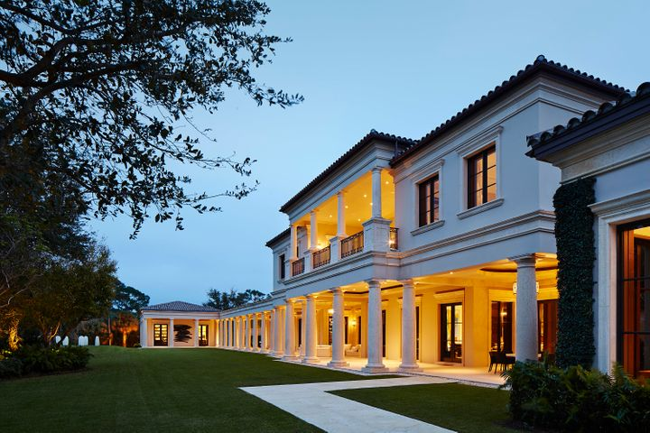 This exquisite Palladian-style estate, previously featured in Architectural Digest, was designed by architect Manuel J. Diaz and built by Lavelle Construction in 2010.  Situated on a large double lot in the prestigious Bear's Club located in Jupiter, Florida, the residence offers 33,705 total square feet with 7 bedrooms, 9 baths and 3 half baths.  The property showcases views of the Jack Nicklaus golf course from its expansive outdoor loggias, spacious lawn, serene pool and spa, and covered private second floor terrace.  The main house offers great attention to detail throughout including high ceilings and doors, custom moldings and built-ins, marble floors, beautifully proportioned rooms, a full house generator, hurricane impact doors and windows, and the most spectacular master suite with a dressing room, safe room, gallery hall and a sensational bathroom that serves as a spa-like retreat.  In addition to the main residence is a spacious office conveniently located next to the master wing complete with an en-suite bath, walk-in closet and gym surrounded by floor-to-ceiling windows showcasing the beautiful garden and golf course views.  There is also a separate two-story guest house with an office, two bedrooms and two baths, and a living room, kitchen, and laundry.