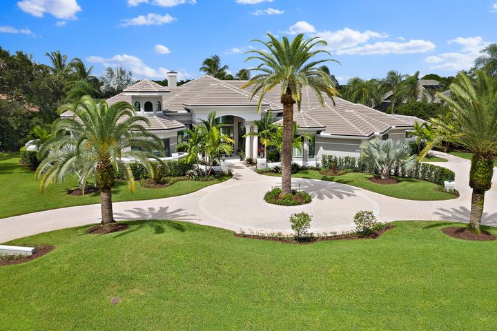 Spectacular estate in Loxahatchee Club completely renovated 2018 on rare over acre lot 1 of  4 double lots in this community. An entertainer's dream home with lake & golf course views seen the moment you reach the front door.Open floor plan boasts 20' coffered ceilings upon entry and spectacular, glass & suspended wire custom wine room holds/ 380 bottles.Gourmet kitchen to please even an iron chef with 10'x5' island & 6' custom made range from France.Oversized Master suite has separate his/her bathrooms & closets. Her's with 12' ceilings & island also master laundry room. 3-car garage with outdoor carpet and built ins.State of the art theatre.Large lanai & outdoor kitchen.House opens up with two walls of folding,stack back doors. Putting green & oasis pool. Multi options for a 4th BDRM