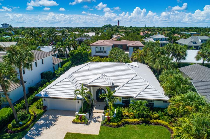 Spectacular total renovation of one story home in Jupiter Inlet Colony, just steps away from the ocean! This gracious 4 bedroom, 3.5 bath home with 2 car garage features the best of everything - oversized eat in kitchen that opens up to the great room and dining area, stylish porcelain wood floors throughout, exceptional workmanship and the highest quality finishes.  Voluminous ceilings & disappearing (pocketed) glass walls open to new travertine patio & saltwater pool. 3 King size bedrooms plus 4th or den. Barn doors open to exquisite, marble bath from spacious master bedroom. Exceptionally beautiful landscaping. Full renovation includes: all new kitchen, appliances, volume ceilings, new roof, new impact doors/windows, new front door, everything is new... almost New Construction. Professionally designed, decorated & landscaped  move in ready! Walk to pristine, secluded beaches, optional beach club membership available.  Jupiter Inlet Colony is a uniquely private cluster of 240 custom residences located at the southern tip of Jupiter Island. Surrounded on three sides by water; the Atlantic Ocean, Jupiter Inlet, and Intracoastal Waterway, this relaxed setting offers pet friendly beach access for a myriad of recreational sports and activities. The Jupiter Inlet Colony Police Department offers 24/7 manned patrols and other security features that are unmatched in the area. Best of all, Jupiter Inlet Colony boasts a private beach club with optional membership based upon approval. Located on the Atlantic Ocean on the northern edge of the mouth of the Jupiter Inlet, this club has some of the best views in town.