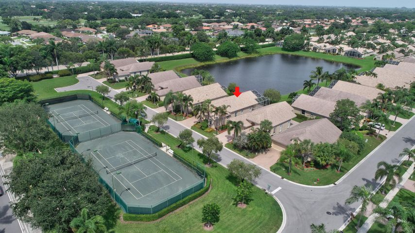 Enjoy your Expansive Lakefront Patio with Tennis Courts right across street