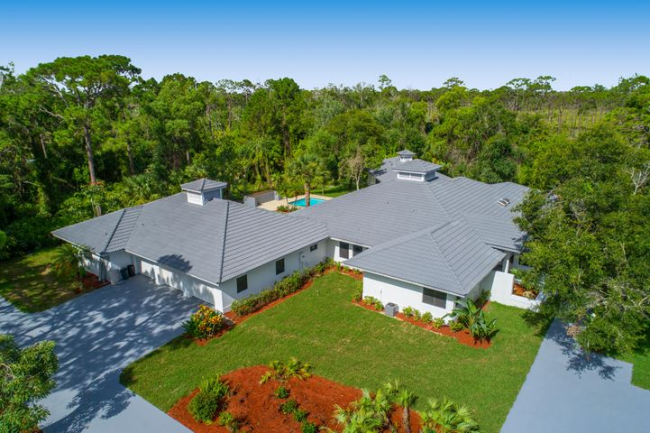 2 ACRES OF LAND & EAST OF 195, SPRAWLING 6000  SQ UNDER A/C & OVER 8000 TOTAL SQ FT ESTATE IN  GATED COMMUNITY AT PRIME JUPITER LOCATION! NEW PRICE & REDUCED BY $400,000, THE OWNER IS MOTIVATED & WANTS TO SELL THIS HOME!! THIS OVERSIZED ESTATE HAS 2 SEPARATE LIVING AREAS, ITS PERFECT FOR LARGE FAMILY WITH INLAWS FOR SEPARATE GUEST HOUSE. TOTAL 2019 RENOVATIONS INSIDE, OPEN NEW FLOOR PLAN, ALL NEW BATHS, ALL NEW KITCHEN, NEW FLOORING, GORGEOUS OPEN MODERN POOL LOCATED ON COMPLETELY PRIVATE PRESERVE. THIS HOME IS FOR THE BUYER THAT WANTS TOTAL PRIVACY, PEACE AND QUIET IN A GATED COMMUNITY.