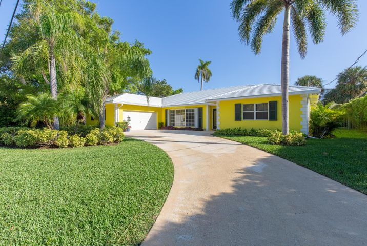 This mid-century Bahamian Architecture home is nestled at the Southeast edge of Ibis Isle in Palm Beach. Features 3 Bedrooms,one used as Den and 3 1/2 baths 1 is a full cabana bath. The guest bathroom is tiled. Formal Living and Dining Room, with bay window. Limited access to ocean, from the lagoon, with floating dock, perfect for small boat or jet skis,canoes,kayaks. Clean and modern, large pool area for entertaining, a 2 car garage. Hear the ocean waves break over the sand with steps at Phipps Beach. Minutes to Worth Ave and Palm Beach Airport. You will not want to miss this once in a lifetime to own a single family home with water options under 3 million. Could be a tear down with newer larger homes in the the exclusive and quiet 32 home area of Ibis with only 22 waterfront homes