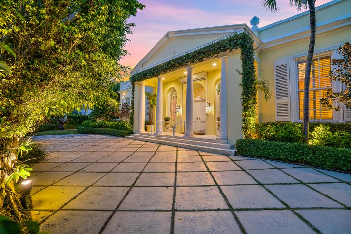 Elegance and charm make this Premier Regency Estate an absolute must see. Located on most desirable north end, close to Palm Beach Country Club, deeded beach access, over-sized lot over 17,400 sq ft, 3 bedrooms and 4 full and 3 half bathrooms, 5,199 sq. ft. exquisite detailing, exercise room, working fireplace, large pool surrounded by expansive landscaping, covered loggia with several sitting areas and full house generator.