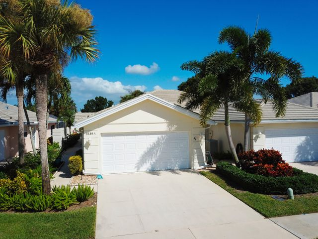 Check out the 3D Virtual Tour for this gorgeous 2/2 villa with pool in The Lakes at St Lucie West. Featuring a freshly updated kitchen, updated tile and wood flooring throughout the house, walk-in tub in the guest bath, living room without the original builder's built-in, and much more! Step out to the large screened patio and pool deck with lake view for your daily dose of serenity. Built with the renowned DiVosta solid concrete design, polybutylene remediation complete, tile roof (2011), and accordion shutters around the back patio, this house will stand up to any Florida weather. The Lakes offers fantastic amenities (including clubhouse, tennis, pickleball, and more) for one of the lowest HOAs in the area and is ideally located in the middle of St Lucie West's best stores.