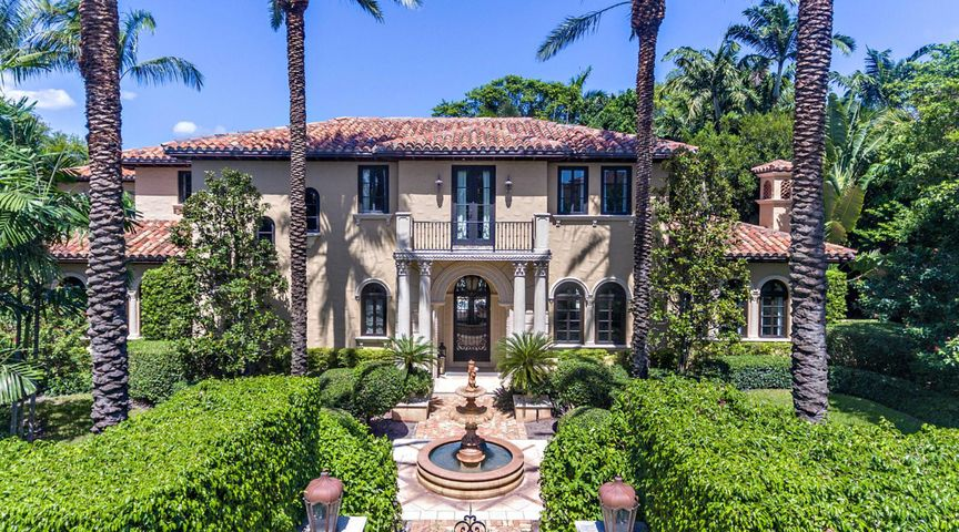This magnificent gated Mediterranean home embodies the best of resort living in the estate section with deeded beach access and membership to Mar A Lago included. Thoughtfully executed floorplan built by Ecclestone Homes in 2002, this home offers spacious rooms, great closets, eat in kitchen, wood paneled library, wine room, beautiful loggia facing the pool with summer kitchen, 3 car spacious a/c garage. Many updates and renovations completed. Ready to be enjoyed this season.