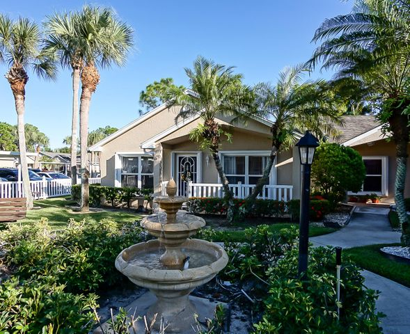 Move in ready corner Courtyard Villa in the Isle of Venice. Tile throughout including the front porch and rear lanai of the kitchen. Lots of natural lighting.  Extra counter and cupboard space in the large eat in kitchen.Stainless  Dishwasher, microwave, range are New as are the Accordion Shutters. Large Master Bedroom with walk-in closet. Laundry room off kitchen with plenty of room for storage and/or a small office. Courtyard is charming. Covered Carport. In the heart of Saint Lucie West. Restaurants, New York Mets, doctors, movies and shopping close by.