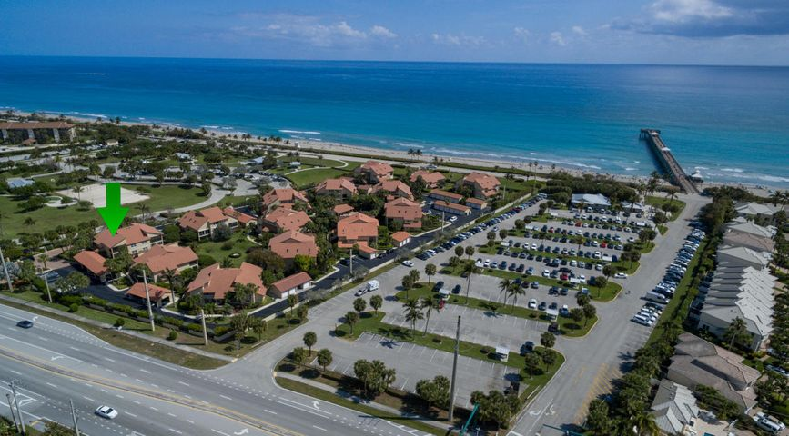 This updated two-bedroom, two-bath condo is situated between the Ocean Cayand Juno Beach parks just north of the Juno Pier and only steps from the beach in the beautiful, gated community of Beachcomber. Enjoy the spectacular Florida weather, breathtaking beach sunrises and convenient walking distance to groceries, dining, and great shopping.You'll fall in love with the bright and roomy interior updated with all new flooring, upgraded bathrooms, popcorn ceilings removed, and fresh new paint throughout. The spacious floor plan delivers a large dining area open to the living room, a master suite with walk-in closet and vanity area, and a well equipped kitchen with granite counter tops and new stainless-steel appliances.  Brand new A/C was installed in May 2017, and the screened in patio was fully restored in September 2017. Beachcomber is a charming oceanfront community comprised of 14 separate buildings with a total of 56 condos complete with a beautiful community pool and soothing spa. The architectural style has a more tropical feel than some other Jupiter Oceanfront condos, and outside you will find tropical vegetation like palm trees, flowering oleander, and sea grapes.