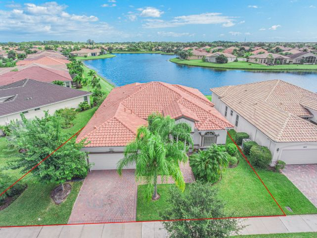 Discover this 4/3 (or 3BR plus den) Levitt-built lakefront pool home with so many upgrades! Whole-house generator, new dual-zone A/Cs in 2017, fenced yard, tile everywhere, impact windows and doors, new refrigerator, and so much more! Watch the sun rise over the lake from your patio. Separate formal living and dining rooms flow into the open concept kitchen and family room, bathed in light from the clerestory windows and sliding glass doors. The master suite offers walk-in closets and a spa-like bath. Organizing is a breeze with the large closets and built-in cabinetry. Tray ceilings accent the master, master bath and formal dining room. This meticulously maintained home even includes 3 security cameras and 5 mounted televisions! Enjoy preparing food on your gas range, with all you need stored in 42-inch cabinets or the kitchen pantry -- no wire shelving here! Appliances are SS, counters are granite, and cleanup is easy thanks to the central vacuum system. In addition to the screened back patio, the front porch also is screened for those flow-through breezes. Brick paver driveway, walkways and patios frame the home. The pool is heated for year-round comfort, and all equipment is included. A complete gutter system efficiently wicks away stormwater, too! Truly a must-see home! Vitalia is a vibrant 55+ community with a huge clubhouse, pickleball courts and other resort-style amenities.
