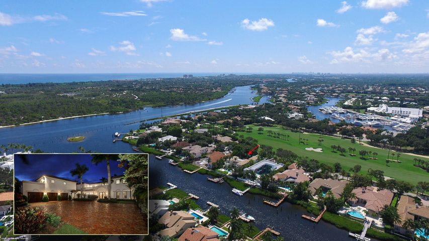 Custom waterfront estate home steps from the Intracoastal Waterway. This estate is perfectly situated on the championship golf course in the front yard and waterway and Intracoastal views in the backyard. The home boasts magnificent features throughout including a chef's kitchen which is open to the family room, first floor master suite, hardwood and stone floors, an elevator and impact windows throughout. Guests will enjoy their private space whether it's in an over-sized VIP suite or the mini apartment with a private entrance. Recently updated resort like pool and spa and a large summer kitchen will draw you in to spend time outdoors relaxing or entertaining. This home, in the prestigious Admirals Cove, is sure to impress.