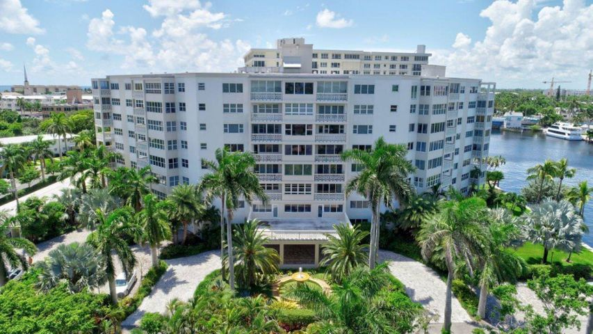Enjoy sweeping pool and intracoastal views from this corner unit with its large wrap balcony with new travertine tiling. Gem beach location: just steps off of lively Atlantic Ave. and a short stroll to putting your toes in the sand at the award winning beach. You're able to walk to everything!Unit has new granite countertops in kitchen and both bathrooms and has been freshly painted. Impact windows throughout. The complex sits on 2+ acres of lush, tropical landscaping with an on site dock where one can watch the daily boat and manatee parade. All major maintenance has been taken care of and there are no pending special assessments. Smoke free building. All ages are welcome; it's a wonderful place to call home!