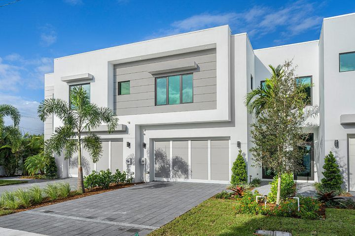 Urban living meets coastal relaxation in this contemporary townhome minutes from town and the beach.