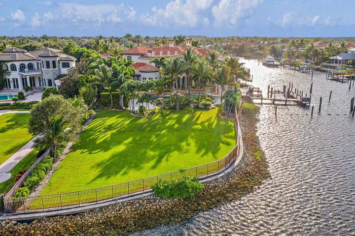 Location Location Location A BOATERS DREAM - Point Intracoastal Lot in Prestigious Admirals Cove.  This property has almost 300' of water frontage, see survey in documents, and is a  one of a kind property.  Dockage on the canal for a 85+/- boat plus 2 additional boat lifts.  A new roof 2019, and the home will also be painted on the interior.  This smart home has a room for everything, wine room, theater, office, golf range, chefs kitchen, guest wings you name it is has it.  Enjoy countless hours outside by the resort style pool, outdoor bar and summer kitchen, covered loggias and one of the largest lots in Admirals Cove.