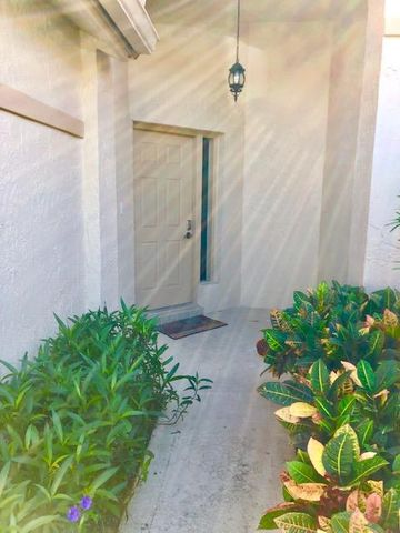 Beautiful Spacious Remolded Town House with Master BR on 1st floor , open floor plan with screened in Patio on Golf course over looking Lake and cross from Club pool