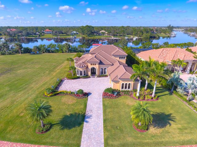 The Riverfront home is located in the private community known as The Island of Ravello where only 65 families will call home. The gated community is on the East Coast of Florida just 45 minutes north of Palm Beach in a quaint Seaside side town only 20 minute drive to the Beach or 30 min by boat. The property was constructed in 2014 to the highest standards with Hurricane impact windows and doors throughout, Impact glass pocket sliding doors open to screened covered lanai with pool, spa and outdoor kitchen, High-end appliances, expert craftsmanship, 2 wet bars, 4 full bedrooms plus office, Master and guest room on main level, Open Great room design downstairs and separate family room and 2 guest rooms upstairs, deep water dockage. All sizes, taxes, HOA approximate.