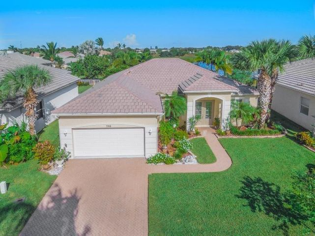 WOW, Beautiful 3/2/2 in the picture perfect gated community of Lake Forest in Port Saint Lucie. Walk through the Impact resistant beautiful cut glass front doors and be wowed by the view all the way to the lake out back!. CBS construction, barrel tile roof, 2 car garage, upgrades every where, tile, soaring ceilings, built in speakers through out! Recent Stainless kitchen appliances, slide out kitchen draws, Large laundry room with basin and cabinets. Full cabinets in the oversize garage, spectacular foyer, Incredible landscaping all around. Beautiful screened back porch overlooking the lake with plenty of privacy to relax in. 2 large sparkling pools, well equipped fitness center, picnic areas, and playground.