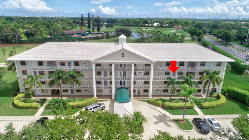 Best location, completely renovated 2 BR/2BA split bedrooms, with an open floor plan, overlooking the recently redone Jack Nicklaus designed Via Mizner Golf and Country Club and a lake view.  Kitchen has granite countertops and stone backsplash, newer refrigerator (2019), breakfast bar between kitchen and living area and no popcorn on ceilings.  Large laundry room with granite counter tops.  Also has extra room that can be used as an office or sleepover area.  Both bathrooms recently updated.  Unit is located on third floor with ready access to updated elevator, lobby and stairs.  Whitehall is a well maintained quiet building with friendly neighbors and a private pool and clubhouse nearby for enjoyment.  Very bright and cheerful. See supplement Excellent schools, close to Sugar Sand Park and shopping, including Town Center Mall, restaurants, banks, I-95, Florida Turnpike, etc.  Ready to move in!!