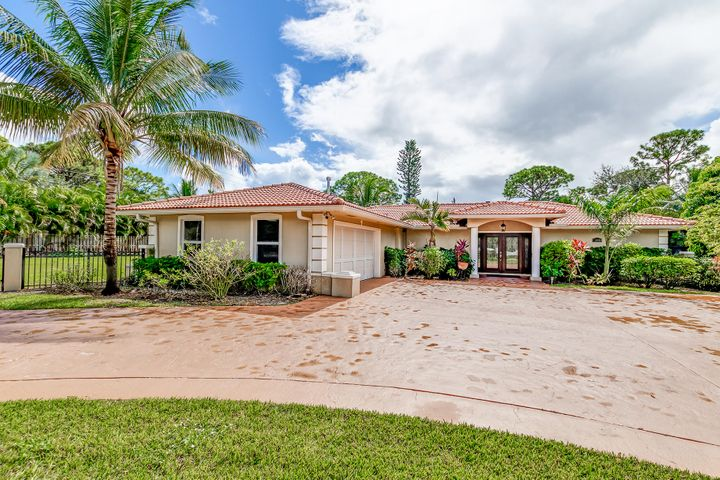 MOTIVATED SELLER. BRING ALL REASONABLE OFFERS.. Beautiful house set on a 1.5 acres with a deeded dock on Loxahatchee river for up to 30 foot boat maybe more. Has fruit trees and a huge fenced in yard with a private pool in the back yard. No restrictions of pets or trucks. House was completely redone in 2005. Everything is up to date. Bring your discerning buyer and you will not be disappointed. Call LA for showing instructions..All dementions of the rooms and the lot are approximation..IMPACT DOORS & WINDOWS THRU OUT....