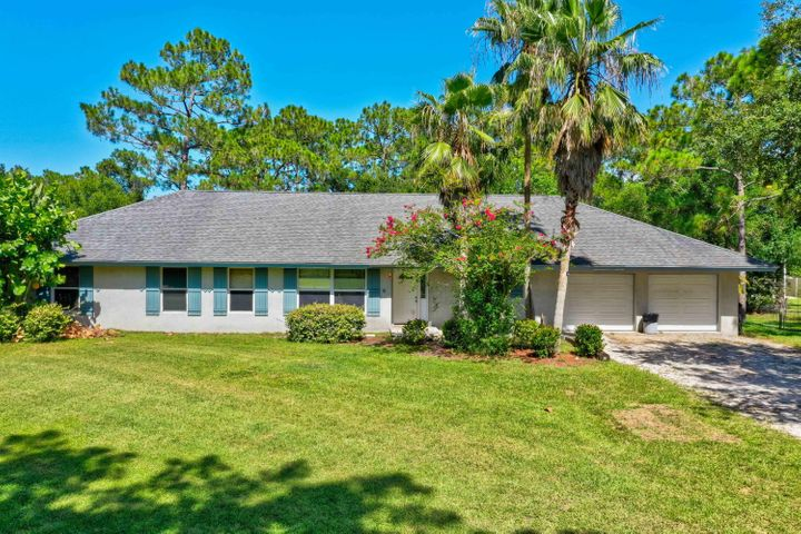 4 BEDROOM CBS HOME WITH POOL/SPA OVER 2500 SQ. FT FOR UNDER 450K!!! Walk to ''A'' rated Jupiter Farms Elementary! Zoned for ''A'' rated Jupiter High and Independence Middle Schools.Close drive from Indiantown Rd.! Plenty of room for all your toys! Bring your RV, boat, and more! Perfect for your pets to enjoy the fenced and cross fenced acre and a quarter! Electric gate at the front of property. Second gate at front also. Gorgeous newly remodeled master bath in with cast iron tub, dual sinks and large walk in shower! Swim in your pool/spa or relax on the stunning cedar screened in patio! Vaulted ceilings, formal dining room with hardwood floor. Huge 2.5 car garage with large storage area. Flooring credit of $2500 offered. Roof replaced in 2007, AC, hot water tank replaced in last few years.