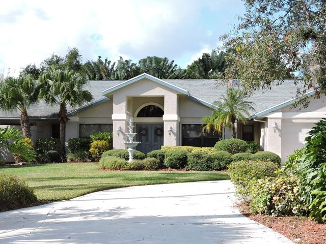 Beautiful Vikings Landing Gated Community. This lovely home sits on over half an acre and has 4031 sq ft under air. The great floor plan allows for privacy. Two master bedrooms. First spacious master suite has a sitting area and large walk in closet on one end of the house. The second master is on the other end with two additional bedrooms. Delightful light & bright living room with pool view, Den/Office near entrance. Eat in kitchen has granite counter tops, wood cabinets, and an open view to the sunken family room with fireplace. Special area for your pool table adjoining the family room and bonus room. Ideal for a studio/exercise/ card or craft room. Paradise pool area with spacious pool and spa in large screened enclosure. Wet Bar off of kitchen area.Click MORE... 3 A/C units, 2 wells, accordion shutters all around except studio room has impact glass and panel shutters. Central Vac and zoned sprinkler system on well. Home decorated in neutral colors. Storage area in the community for your Boat or RV. C-24 Canal Park Boat Ramp a couple blocks away. Room sizes approximate. Paradise pool area with spacious pool and spa in large screened enclosure.