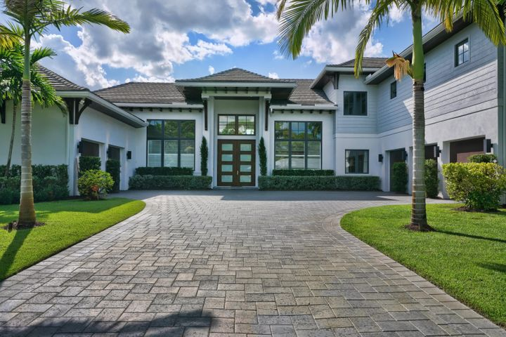 "Stunning Custom-Built totally private estate home sits on 1.27 acres in Jupiter east of I95. The main living quarters has the master suite, dream gourmet custom kitchen with Thermador appliances, pantry,  guest suite, office, dining room, possible 6th bedroom or nursery.  Over 1100 square foot attached living quarters/ media center with separate covered entrance, a full cabana bath and attached 2 and 3 car garages. Upstairs living has 3 full bedroom suites with solid marble baths and huge walk-in closets, additional office/ bonus room and a wet bar with refrigerator. Large 10' tall by 8' wide custom solid double mahogany entry doors and transoms. All exterior soffits/corbels/brackets/overhangs/ are stained solid cypress wood. Kolbe & Kolbe wood clad hurricane impact windows and swing doors and large 10' tall corner door. All trim is solid wood with custom profiles. The entire home has a top of the line whole house RO water filtration system, all the wood floors in main living area are gorgeous 12"" European oak, WHOLE home automatic backup generator/1,000 gallon gas tank, whole house smart automated control system including lighting, audio and entertainment, all bathrooms outdoor kitchen pool decking and wet areas solid marble, custom chandeliers and LED high hats throughout, solid wood plantation shutters and icynene insulation. Custom heated pool and spa, large outdoor kitchen and entertainment area. Total separate fenced in parking area for your RV and boat."