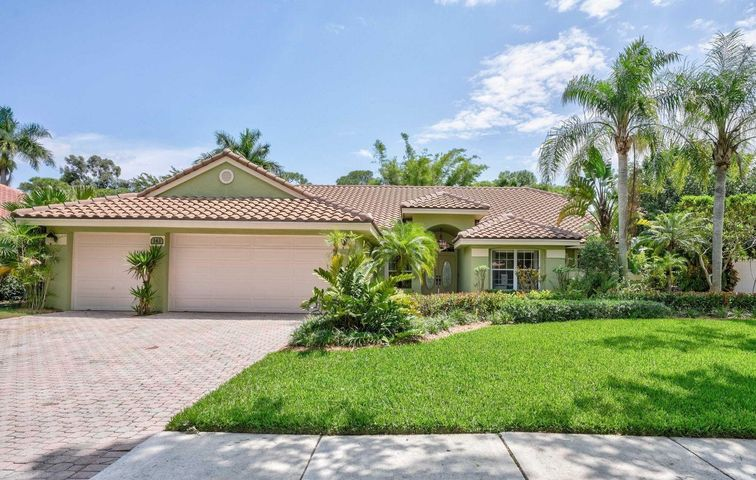 """Located in one of the most desirable gated communities in Jupiter, this Single Story, 4 BR, 2.5 BA, 3 Car Garage, Pool home offers an abundance of upgrades, inside a well-built, bright, perfectly laid out home.  Newly resurfaced & polished travertine floors embellish the main living areas.  A Beautifully designed, custom-built kitchen is luxuriously outfitted with striking granite countertops, stacked subway tile backsplash, tall hardwood  'soft close' cabinets, & pullouts that make use of every nook & cranny.  The home wraps around the outdoor living space, offering beautiful views of the pool & garden from the living room, family room, kitchen, & master  bedroom.  A 4 yr. NEW ROOF, hybrid water heater, & prime lot, at the onset of a CUL-DE-SAC, make this home a unique & valuable find. The kitchen opens to a bright breakfast nook and spacious family room, with stylish wainscoting. The grand master suite has vaulted ceiling's, engineered hardwood floors, walk-in closet, and an enviable master bath, outfitted with top-of-the-line Kohler fixtures, marble tile with decorative inlays, luxurious shower, with multiple showerheads & jets, separate soaking tub, and travertine floors. Kohler """"Quoizel"""" light fixtures illuminate all the bathrooms with gorgeous colored glass & oil-rubbed bronze finishes.  Relax or entertain in your large, private, backyard haven, with a screened in pool and lanai, paved side patio, and additional green space, surrounded by tall/lush landscaping, including magnificent Mahoe Hawaiin Hibiscus trees.    This home resides in the coveted, private community of North Fork, with mature, tree-lined streets, gated entry, and a park-like setting.  An A-rated school district, and a location within minutes to beautiful beaches, world class golf, fine dining, great shopping, and countless entertainment venues, round out this home's overall appeal.  With easy access to I-95 & the FL Turnpike, and only 25 minutes to PBI Airport, you can live in paradise, with t"""